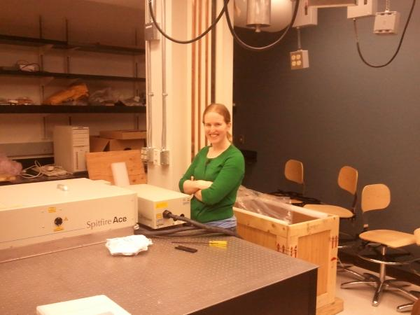 Becky inspects our new amplified laser system.