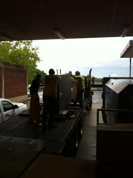 Loading the laser tables on the flat bed.