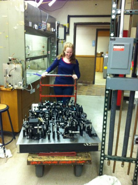 Becky wheeling all of the optics out of the old lab.